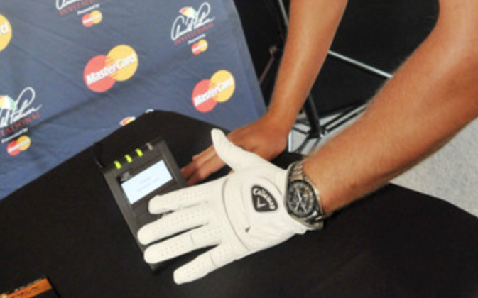 Paying with a  Callaway golf glove with MasterCard payment tech inside.  --Image courtesy of MasterCard.